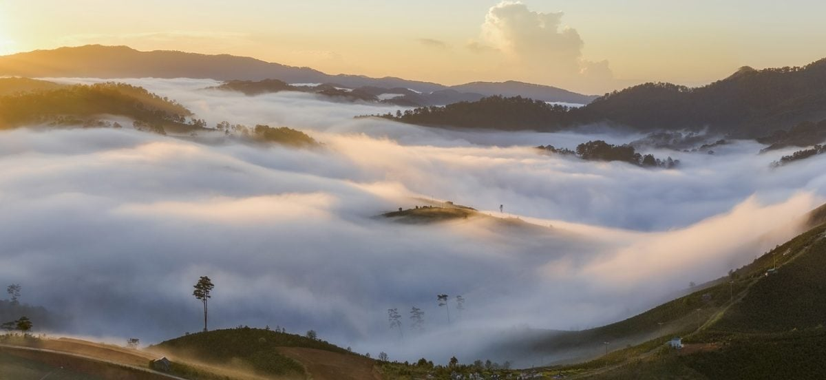 Looking down on a cloud filled valley at dawn