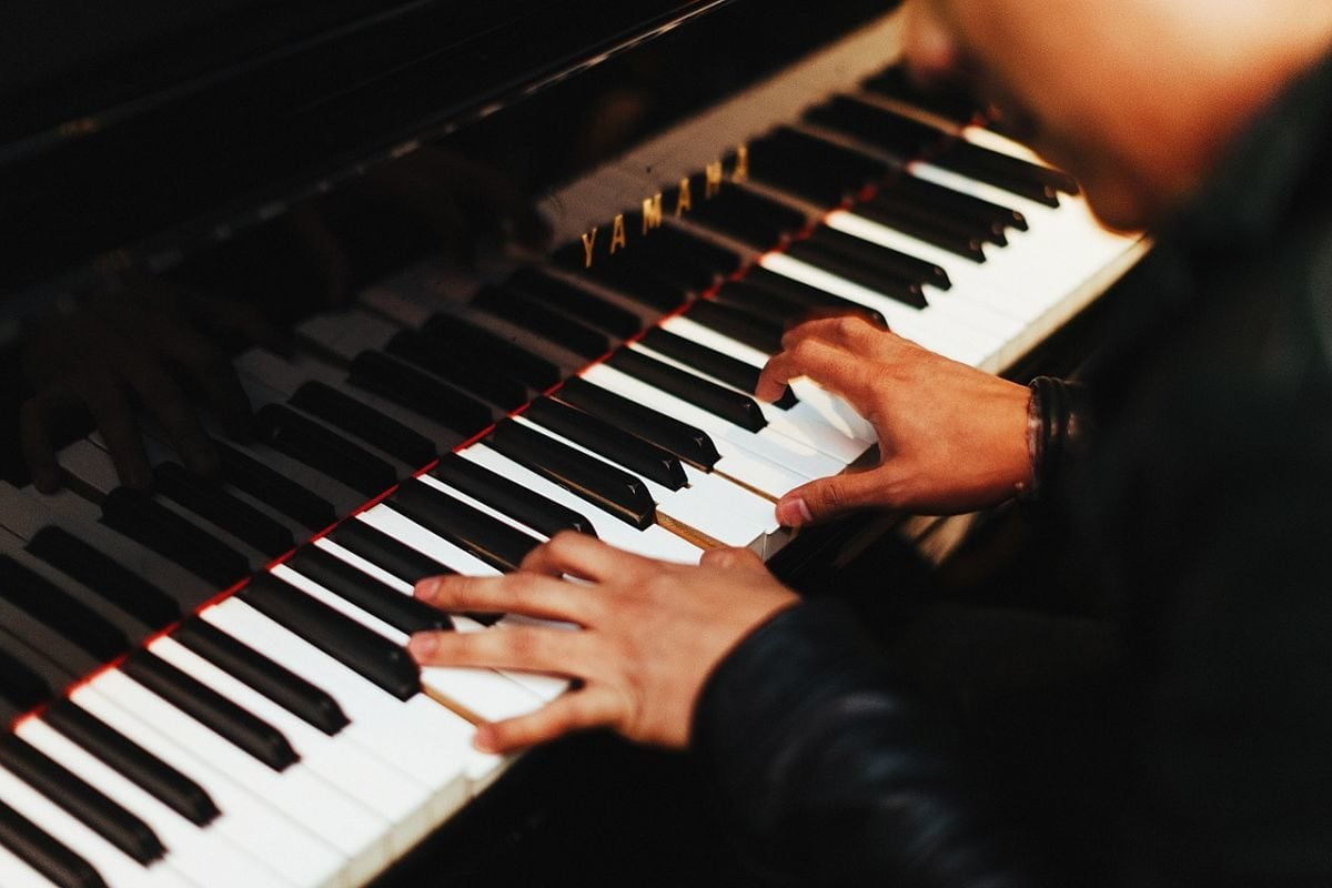 Close up of of person practicing piano