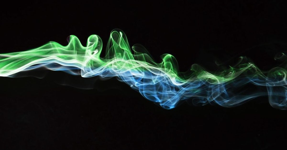 Abstract multi-coloured wiggly tracings on a jet black background, bright on left side, fading toward the left.